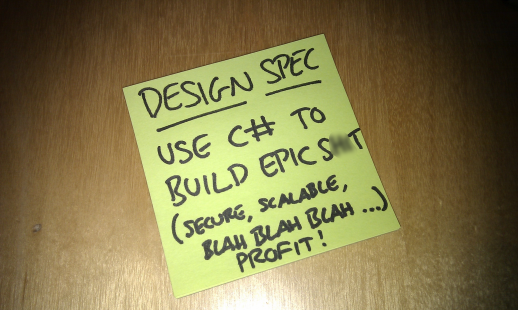 "A post-it note reading ""Design spec = Use C# to build epic s**t (secure, scalable, blah, blah...profit!)"""